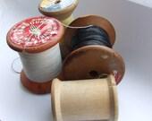 Four pretty vintage cotton reels