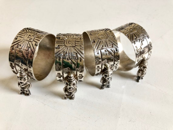 Set of Four Sterling Silver Peru Napkin Rings with Mythological Theme