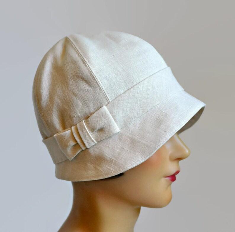 Cappello Cloche da donna in lino crema con arco 1920 ...