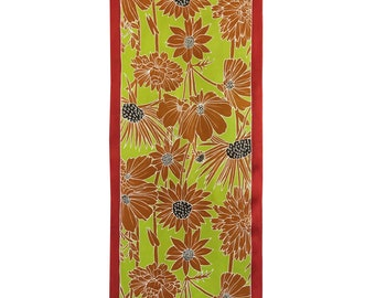 Floral print scarf with golden flowers and yellow/green background