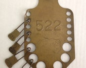 unique circa 1920s - wall mount vintage industrial laundry tag holder with numbered pins - keyes davis