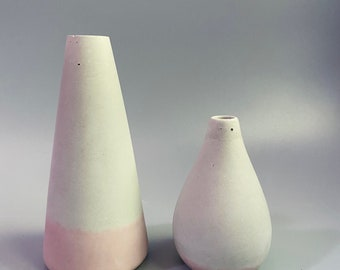 Cement vases. The pair,  one tall and one round. In rose bottom. Industrial style decor