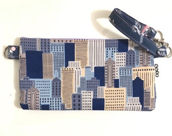 Sofs offers a wristlet, little pouch bag in city scape with sweet gardens