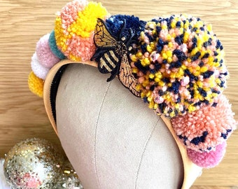 Pompom Crown Headband in Mustard Navy and Coral Pink. Finished with a Golden Bee.
