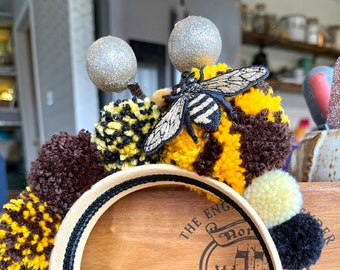 Bumble Bee PomPom Headband Crown on a comfy wide yellow headband.