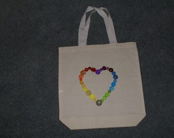 Rainbow heart button design on a cotton tote bag