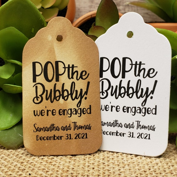 """Pop the Bubbly we're Engaged (my MEDIUM tag) 1 3/8"""" x 2 1/2"""" Personalized Wedding Engagement Shower Favor, popped the question, were engaged"""