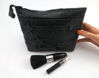 Cosmetic pouch for men and woman, recycled bike inner tube, handcut flower decoration container, bag, with black zipper.