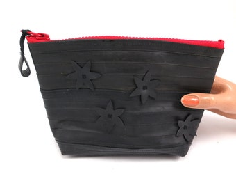 Cosmetic pouch for men and woman, recycled bike inner tube, container, bag, with red zipper.