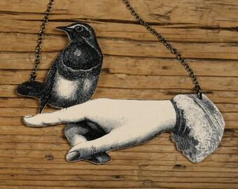 Bird in Hand Necklace