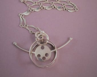 Circus wheel pendant necklace in sterling silver.  Artisan handmade. One of a kind.
