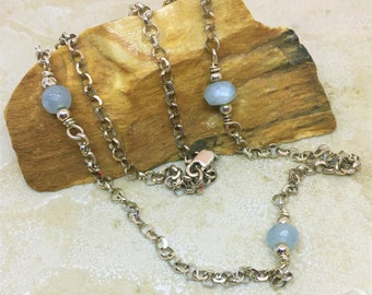 Layering necklace in sterling silver rolo links with faceted aquamarine. 20 inch layering necklace with aquamarine in sterling silver