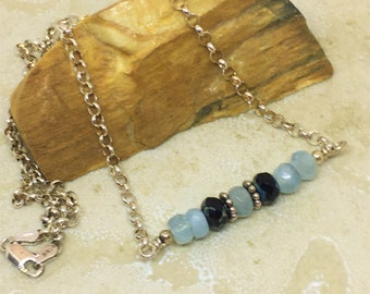 Aquamarine bar necklace in sterling silver with rolo link chain. Blue and black beaded 18 inch bar necklace in sterling silver