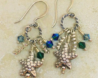 Sea shell tropical earrings in sterling silver with dangle charms and Swarovski crystals. Beachy tropical earrings for summer or travel