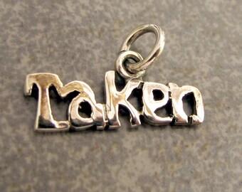 Sterling silver TAKEN charm. Polished charm. 20 x 15 mm. Solid Sterling silver Taken charm pendant. Valentines