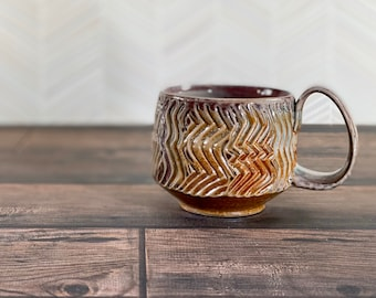 Petite soda fired mug // Stoneware mug with wiggly texture, sprayed glazes, handmade mug with facets. Toasty warm soda fired mug