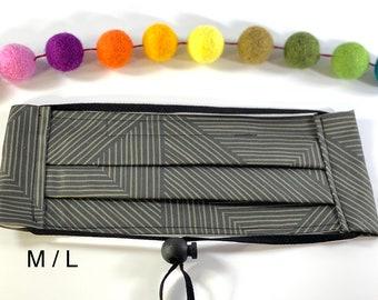 3 layer Medium Large face mask black // geometric black and tan large reusable mask with elastic straps around head, toggle + nose bridges