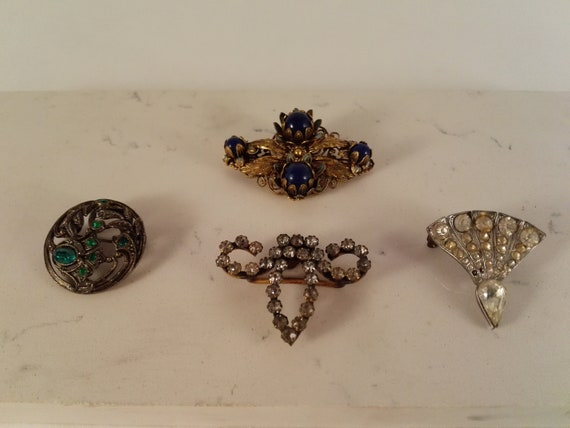 3 Antique C clasp costume brooches and one crystal
