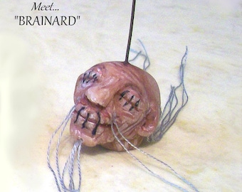 """A Ghoulish Shrunken Head  """"Brainard"""" is a Realistic 1"""" Original Hand Sculpted Hanging Ornament for Your Mini Haunted House"""