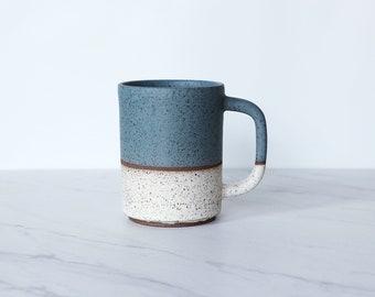 16 oz ceramic mug, speckled clay, glazed in teal + cream.