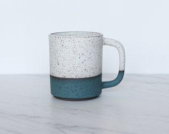 12 oz ceramic mug, speckled clay, glazed in cream + teal.