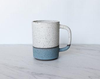 16 oz mug, speckled clay, glazed in cream + turquoise.
