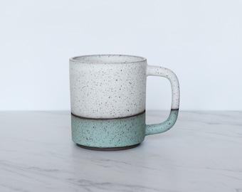 12 oz ceramic mug, speckled clay, glazed in cream + mint.