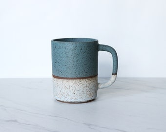 16 oz mug, speckled clay, glazed in teal + ice.
