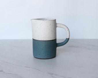 Pourer/Creamer, speckled clay, glazed in cream + teal.