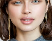 Long Alia gold arc earrings, gold chain earrings, asymmetrical statement earrings