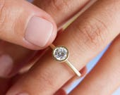 Emilie, round cut diamond engagement ring, solitaire gold engagement ring, minimalist engagement ring yellow gold, modern engagement ring