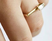 Perla, asymmetrical engagement ring, asymmetrical diamond ring, geometric engagement ring, geometric diamond ring, baguette engagement ring