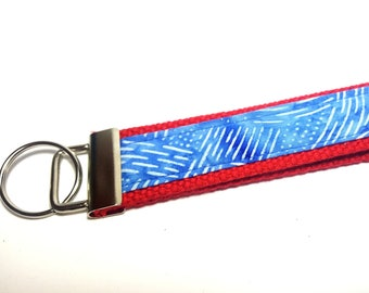 Red, White and Blue Chalk Like Impint Keychain on Red Cotton Webbing