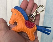 Small size - Beon the epi leather horse charm with lobster clasps version ( Orange epi with dark blue cowhide mane/tail )