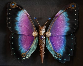 One of a kind steampunk butterfly sculpture with purple, blue and black wings 15'' X 12.5'' X 2,25''