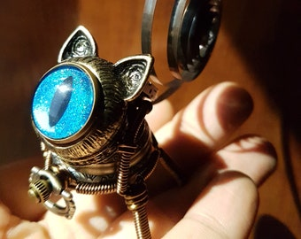 Little Steampunk cat robot sculpture - blue iridescent eye