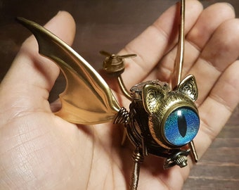 Steampunk Winged Cat Sculpture with blue eye, Dice Guardian, Dungeons and Dragons, DND familiar, D&D art miniature, Role playing games