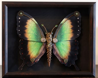 One of a kind steampunk butterfly sculpture with green, yellow and black wings