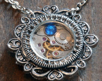 Steampunk Jewelry - Pendant - Watch movement and capri blue crystal