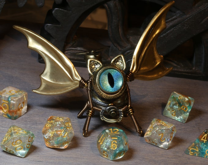 Steampunk Winged Cat Sculpture with  blue green iridescent eye
