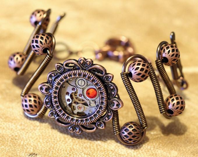 Steampunk Jewelry -  Bracelet - Antique watch movement and fire opal swarovski crystal