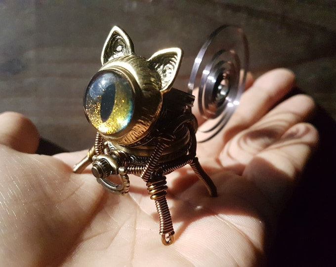 Little Steampunk cat robot sculpture with iridescent eye , golden-green-red-copper