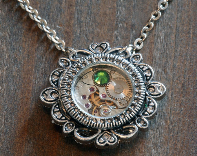 Steampunk Jewelry - Pendant - Watch movement and fern green crystal