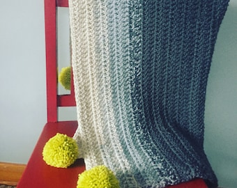 Gray neutral gradient ombre blanket with pompoms