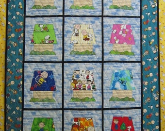 Peanuts Calendar Quilt Kit from Quilts by Elena Includes FREE pattern Fabrics for Roof, Dog House and Grass included