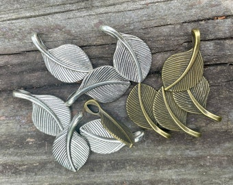 12 Feather/Leaf Pendants. Choice of silver, bronze, or a mix. Small, antiqued. Reversible. Set/12.