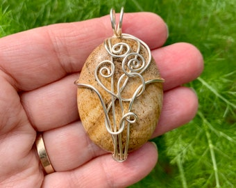 Picture Jasper wire wrapped pendant with silver spirals.