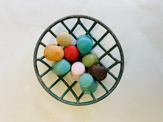 Collection of Vintage Plastic Thimbles in a Wire Flower Frog