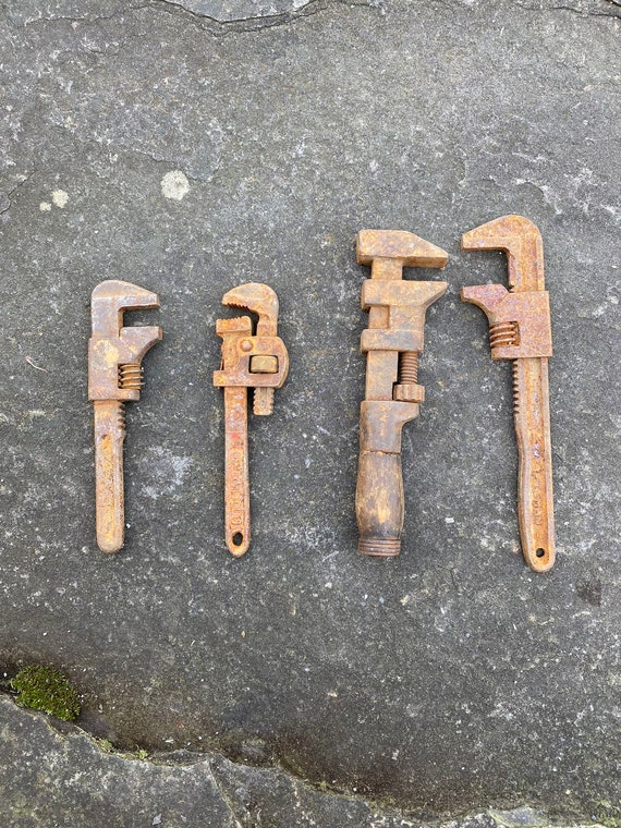 Set of 4 Rusty Pipe Wrenches with Personality