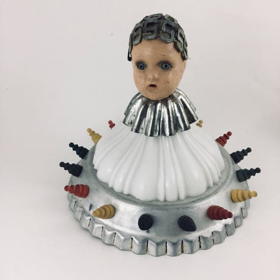 Well-Seated Vintage Doll Assemblage